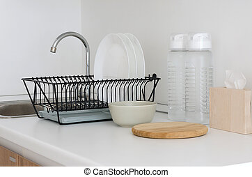 Utensil on white top counter sink in kitchen