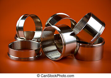steel chromium-plated rings with thread on a red background