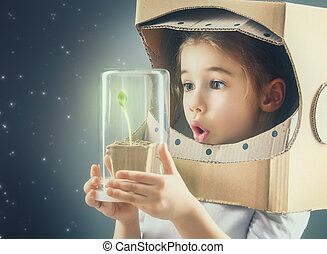 Child is dressed in an astronaut costume. Child sees a...