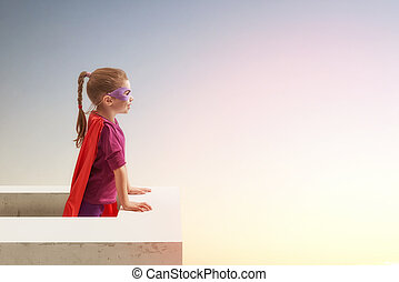 girl in Superhero's costume - Little child girl plays...