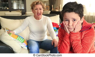 Angry mother scolding little son - Angry mother scolding a...