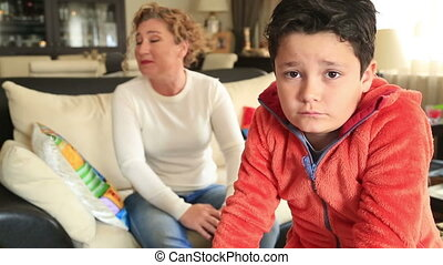 Mother scolding a disobedient boy - Angry mother scolding a...