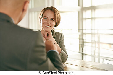 Image of two succesful business people conducting an...