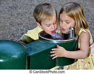 Kids Drinking Water - Kids drinking water from a public...