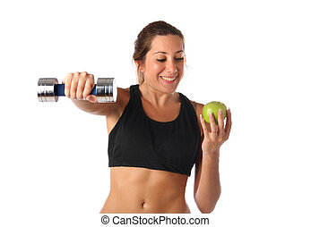 Happy young woman holding a dumbbell and a green apple....