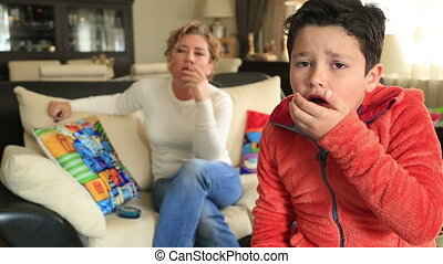 Mother smoking near her coughing child
