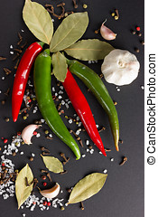Four chili peppers, garlic, bay leaf and spices