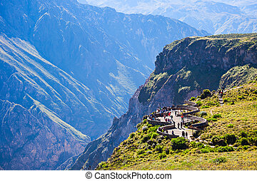 Colca canyon - Tourists at the Cruz Del Condor viewpoint,...