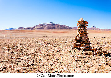 Altiplano, Bolivia - Stones sign and volcanoes in Altiplano,...