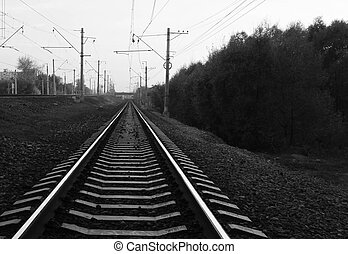 railroad tracks in the city during the day black and white