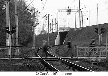 people pass the railroad black and white
