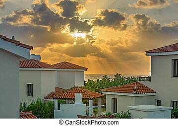 Sunset over beach villas on Cyprus