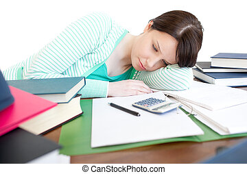 Exhausted bright woman studying on a table in the...