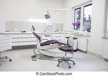 Modern dental practice. Dental chair and other accessories...