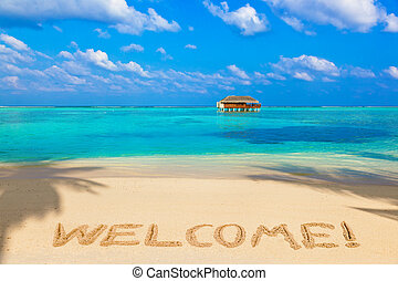 Word Welcome on beach - concept holiday background