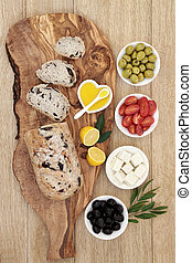 Greek Antipasti - Greek antipasti with olive bread on a...
