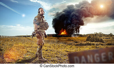 Soldier with the rifle is looking at the smoke