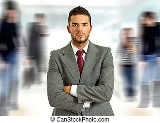 executive - young handsome business man portrait looking at...