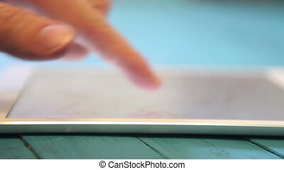 man uses tablet strong blur close-up HD