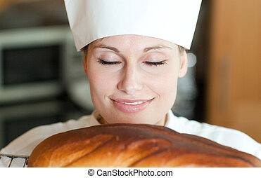 Radiant woman cooking a cake in the