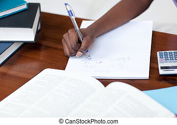 Close-up of an Afro-American girl doing her homework