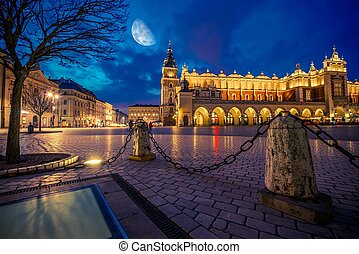 Krakow Main Market Place After Dark with Moon on the Sky....