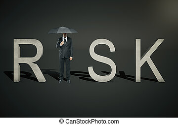 Risk concept businessman on black - Risk concept of...