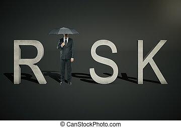 Risk concept businessman on black - Risk concept of...