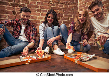 Young people resting - Young people in casual clothes eating...
