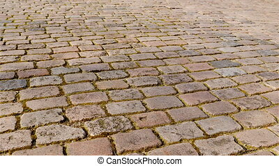 Old cobbled street pan wide - Pan of old cobbled street in...