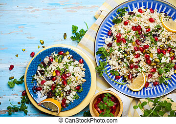 Cauliflower couscous with dried cranberry, pomegranate,...