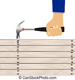 Hand with a hammer. - Hand with a hammer and wooden board.