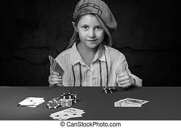 Girl holding a poker card - Smiling young girl in cap...