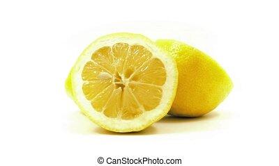 Lemon Slices Turning Slowly - Fresh lemon halves turning...