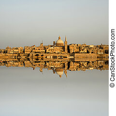 mirror - ancient architecture of malta island with...