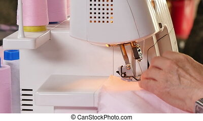 Seamstress Sews Clothes Over Lock - Over lock the mesh edge...