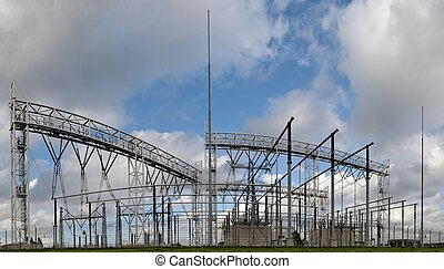 High voltage electric station under blue sky