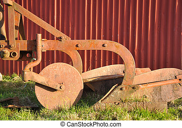 the old plough - An old plough deserted by the barn wall,...