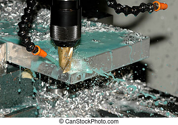 Milling machine is making part while coolant is spraying