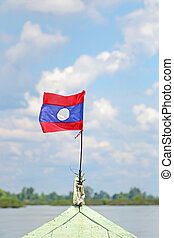 Flag of Laos attached on long tailed boat on the Mekong...