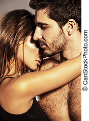 tender embrace - Close-up portrait of a passionate young...