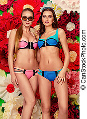 swimsuits - Two pretty girls in summer swimsuits and...