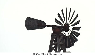 Working Windmill Turning in Strong Wind White Background -...