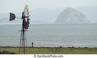 Man Walks Dog Pacific Coast Beach Butte Windmill - Windmill...