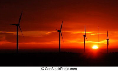 Bright Orange Sunrise Signal Peak W - Wind turbines begin to...