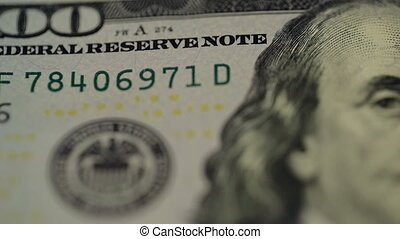 Cash money background. Benjamin Franklin portrait on 100 US dollar bill close up, the image is rotated