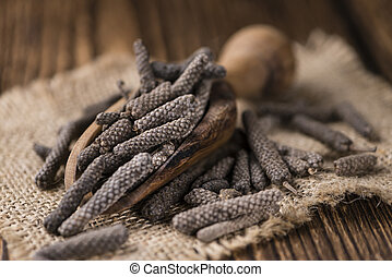 Dried Long Pepper (selective focus) on vintage wooden...
