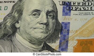 Cash money background. Benjamin Franklin portrait on 100 US...
