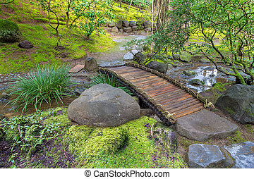 Bamboo Foot Bridge Over Creek in Springtime at Japanese...