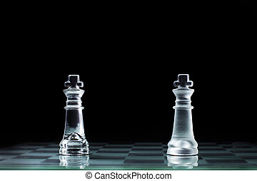 Confrontation - two wooden chess king standing against each...